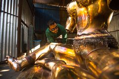 Unidentified Nepalese tinman working in the his workshop. Royalty Free Stock Photos