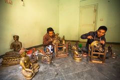 Unidentified Nepalese tinman working in the his workshop. Royalty Free Stock Photo
