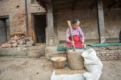 Unidentified Nepalese woman working in the his pottery workshop. Stock Image