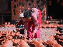 Unidentified Nepalese women making pottery Royalty Free Stock Images