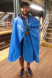 Unidentified 2017 New York City Marathon runner wears finisher medal Royalty Free Stock Images