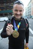 Unidentified 2015 New York City Marathon runner wears medal in Manhattan Stock Photo