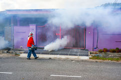 The unidentified officer is spraying chemical for an outbreak of dengue fever Royalty Free Stock Photo