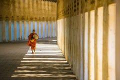Unidentified old Buddhist novice at Shwezigon temple. BAGAN, MYANMAR - DEC 18: Unidentified old Buddhism novice at Shwezigon temple on Dec 18, 2014 in Bagan stock photos