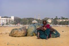 Unidentified old fisherman smoking on Marina beach Stock Photo