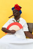 Unidentified old lady with a fine cigar Royalty Free Stock Images