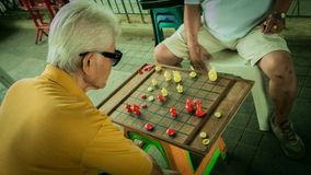 Unidentified old man is racing chess at Bangplat Bangkok , Thailand Royalty Free Stock Images