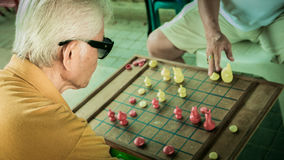 Unidentified old man is racing chess at Bangplat Bangkok , Thailand Stock Photo