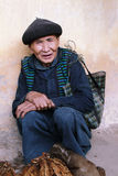 Unidentified old man selling tobacco leaves in Lung Phin market Stock Photos
