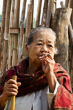 An unidentified old Mon ethnic woman poses for the photo. Stock Images