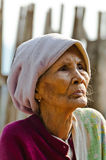 An unidentified old Mon ethnic woman poses for the photo. Royalty Free Stock Photo