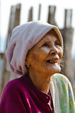 An unidentified old Mon ethnic woman poses for the photo. Stock Photo