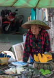 Unidentified old Thai woman sells fruits and snacks in street on July 22, 2015 in Chonburi, Thailand. Stock Photos