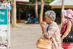 Unidentified old woman chant in wat huay mongkhon Stock Photo