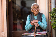 Unidentified old woman near Boudhanath Royalty Free Stock Image