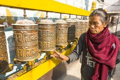 Unidentified old woman near stupa Boudhanath. Stupa is one of the largest in the world Stock Photos