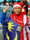 Unidentified old  woman wearing Malaysian flag costume Royalty Free Stock Photo