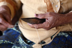 Unidentified old women chamfer thread for weaving thai fabric, C Royalty Free Stock Images