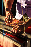 Unidentified old women weaving traditional thai fabric, Chiang M Royalty Free Stock Photo