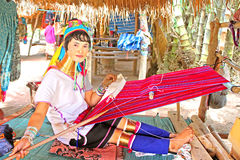 Unidentified Padaung (Karen) tribe woman weave on traditional device near Mae Hong Son, Thailand Stock Photo