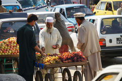 Unidentified Pakistani man sells fresh fruits at market on Octob Stock Images