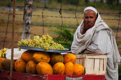 Unidentified Pakistani man sells fresh fruits at market on Octob Royalty Free Stock Image