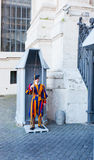 Unidentified Papal Swiss guard standing at the Vatican Museums door in the Vatican. The Swiss guards served since the late 15th century royalty free stock photos