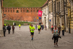 Unidentified participants during the annual Krakow international Marathon. Royalty Free Stock Photo