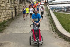Unidentified participants during the annual Krakow international Marathon. Royalty Free Stock Images