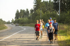 Unidentified participants during of local competitions in Nordic walking. Royalty Free Stock Photo