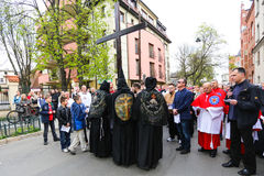 Unidentified participants of the Way of the Cross on Good Friday celebrated at the historic center of Krakow. Royalty Free Stock Images