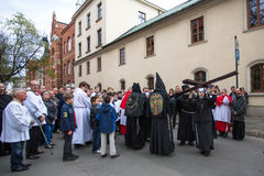 Unidentified participants of the Way of the Cross on Good Friday celebrated at the historic center of Krakow. Stock Photo