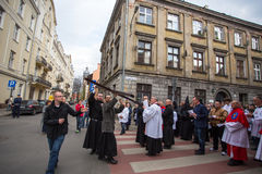 Unidentified participants of the Way of the Cross on Good Friday celebrated at the historic center of Krakow. Royalty Free Stock Image