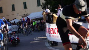 Unidentified partipants of L'Eroica, Italy. GAIOLE IN CHIANTI, ITALY - 5 OCT. 2014: Unidentified participants of L'Eroica, a historic public cycling event for stock footage