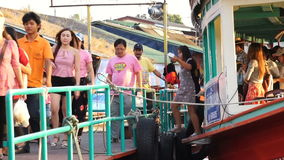 Unidentified passengers getting out of boat travel along the river. NAKHON PATHOM, Thailand - MARCH 3 :Unidentified passengers getting out of boat travel along stock video footage