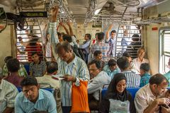 Unidentified passengers inside Indian Railway in Mumbai Royalty Free Stock Photo