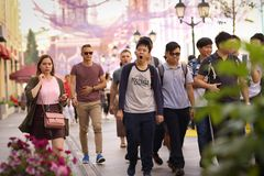 Unidentified pedestrian asian tourists crowd on Mosow downtown s. Moscow, Russia, September 7, 2018: Unidentified pedestrian asian tourists crowd on Mosow stock images