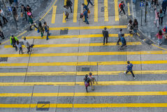 Unidentified pedestrians on zebra crossing street Royalty Free Stock Photos
