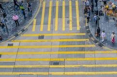 Unidentified pedestrians on zebra crossing street Royalty Free Stock Photo