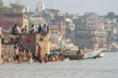 Unidentified people on the banks of the Ganges river Stock Photos