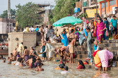 Unidentified people on the banks of the Ganges river Royalty Free Stock Photos