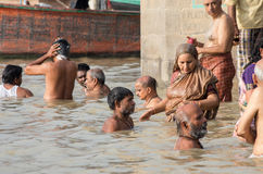 Unidentified people bathing in the the Ganges river Royalty Free Stock Photos