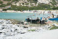 Unidentified people in the beach with blue crystal sea, boats su. Mmertime on July in Villasimius, Italy, Sardinia royalty free stock photography