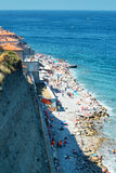 Unidentified people on beach in Piran, Slovenia Royalty Free Stock Image