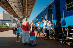 Unidentified people boarding on train on the Royalty Free Stock Photo