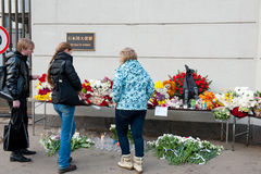 Unidentified people bring flowers Stock Photography