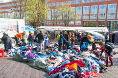 Unidentified people buy clothes in a sale on daily flea market on Waterlooplein (Waterloo Square), the Netherlan Royalty Free Stock Images