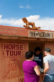 Unidentified people buy Horse tour ticket in Monument Valley National Park. Royalty Free Stock Image