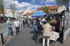 Unidentified people buy souvenirs at the street market in Vilnius, Lithuania. Royalty Free Stock Images