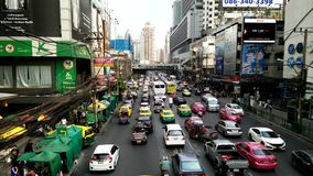 Unidentified people and car at Water Gate in Bangkok stock footage